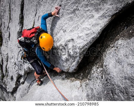 Young woman climbing on a limestone - stock photo