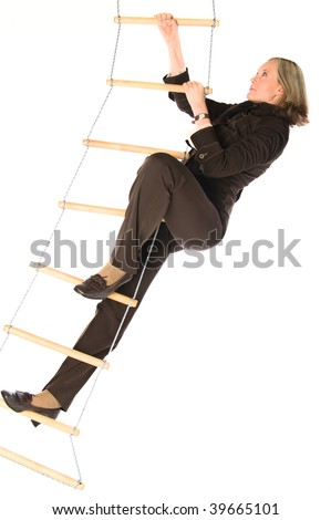 young woman climbing on ladder of success