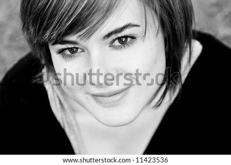 Young woman close portrait in black and white.