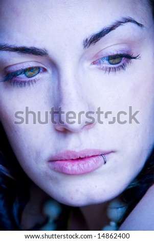Young woman close portrait with impressive eyes.
