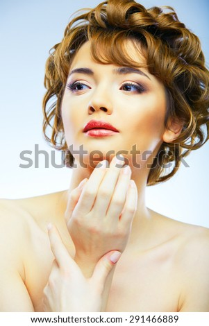 Young woman close up face beauty portrait. Female model isolated white background.