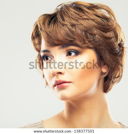 Young woman close up face beauty portrait.Short Hair style Female model isolated white background.