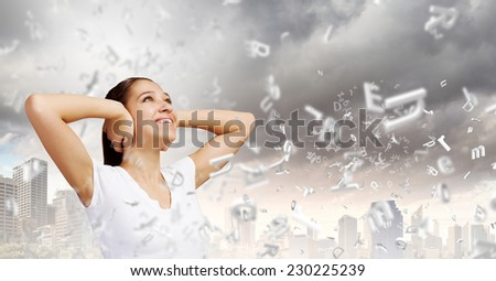 Young woman closing her ears with palms and enjoying the silence - stock photo