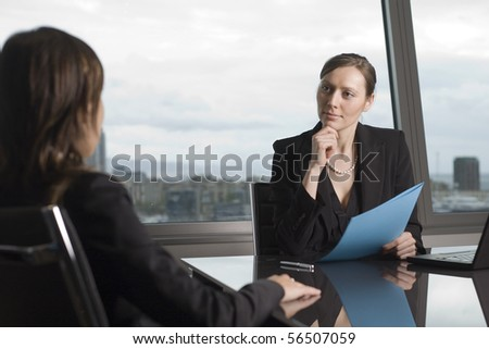 Young woman coming to a job interview - stock photo