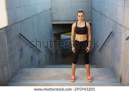 Young woman concentrate before running on stairs - stock photo