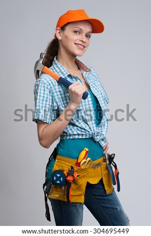 young woman construction worker. Studio shot. Isolated - stock photo