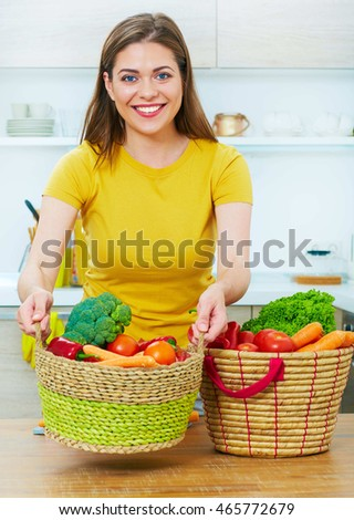 Young Woman cooking food in kitchen. Vegetables diet.
