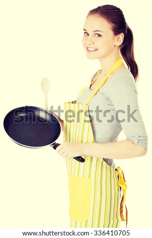 Young woman cooking healthy food. - stock photo