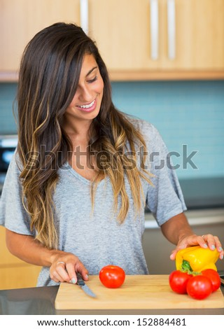 Young Woman Cooking Healthy Food at Home, Perparing Vegetables for Salad. Lifestyle Concept