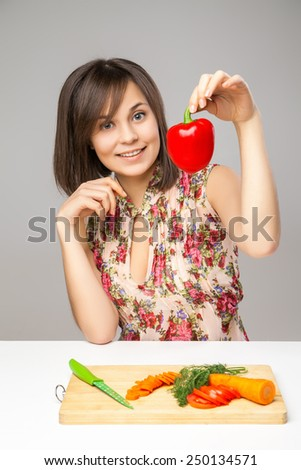 Young Woman Cooking in the kitchen. Healthy Food - Vegetable Salad. Diet. Dieting Concept. Healthy Lifestyle.  Prepare Food