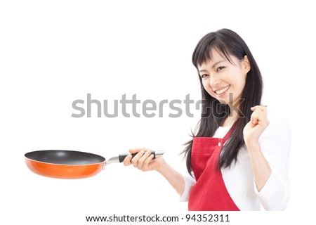 Young woman cooking, isolated on white background - stock photo