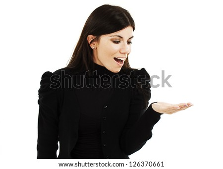 Young woman copy space. Excited young woman presenting your product looking sideways on copyspace with open hand palm. Isolated on white background - stock photo