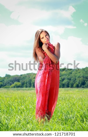 Young woman covered with red fabric - stock photo