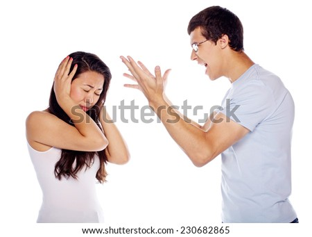 Young woman covering ears from shouting boyfriend on isolated white background - stock photo