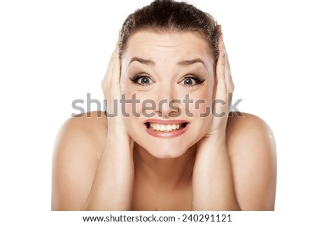 young woman covering ears her hands because of loudness