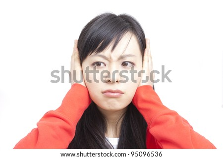 young woman covering ears , isolated on white background - stock photo