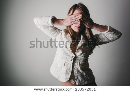 Young Woman Covering Eyes With Hand - stock photo