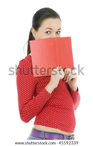young woman covering face by red book - stock photo