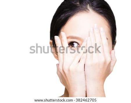 young woman covering her eyes by hands - stock photo