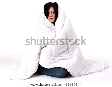 young woman covering her head and body by the duvet