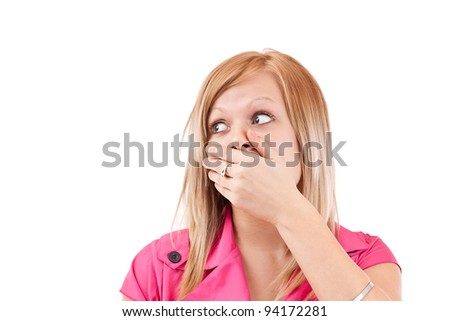 Young woman covering her mouth, isolated on white - stock photo