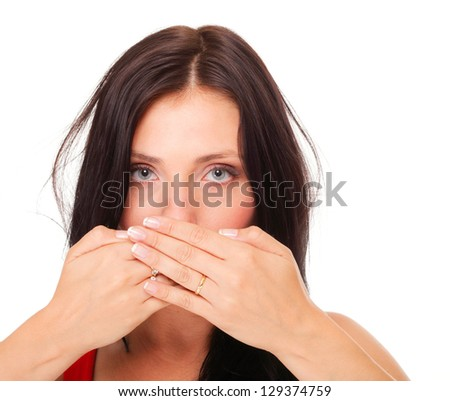 Young woman covering her mouth with both hands isolated over white background - stock photo