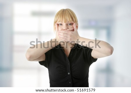 Young woman covering her mouth with hand - stock photo