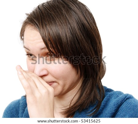 Young woman covering her nose - stock photo