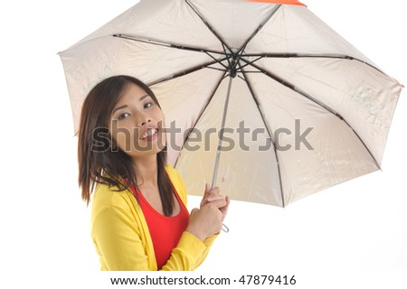 Young woman covering herself with an umbrella