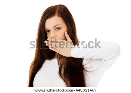 Young woman covering mouth because of shame - stock photo