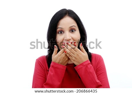 Young woman covering mouth with hands and laughing against white - stock photo