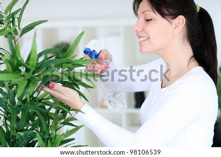 Young woman cultivating flowers - stock photo