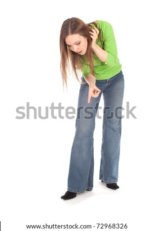 young woman curiosity looking down, showing something, pointing, series - stock photo