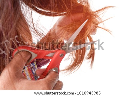 Young woman cutting her hair with scissors - unhappy expression Hair Damage, Health And Beauty Concept, isolated on white background