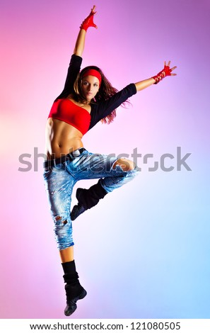 Young woman dancer jumping. On blue and pink background.