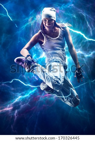 Young woman dancer jumping. With special lightning effect. - stock photo