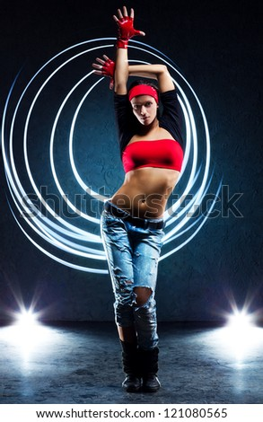 Young woman dancer with lights traces. - stock photo