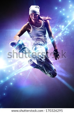 Young woman dancer. With lights traces and sparks.