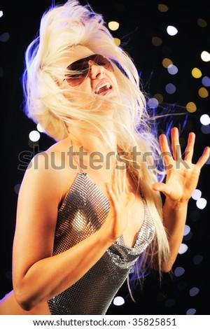 Young woman dancing - stock photo