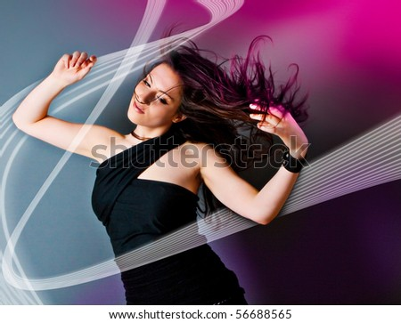 young woman dancing and listening to the music - stock photo