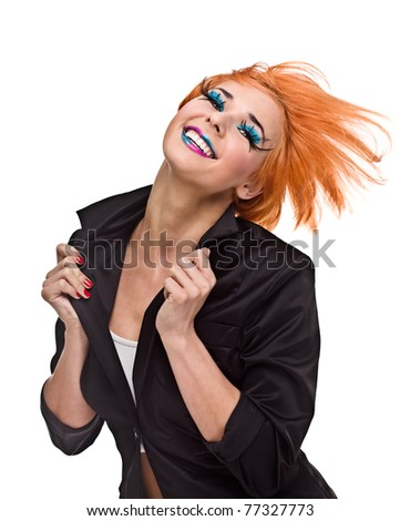Young woman dancing and smiling - stock photo