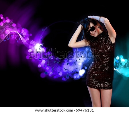 young woman dancing at disco or a night club - stock photo