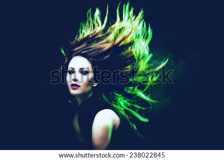 young woman dancing hair in motion green back light - stock photo