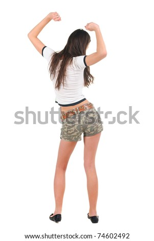 Young woman dancing. Rear view. Isolated over white. - stock photo