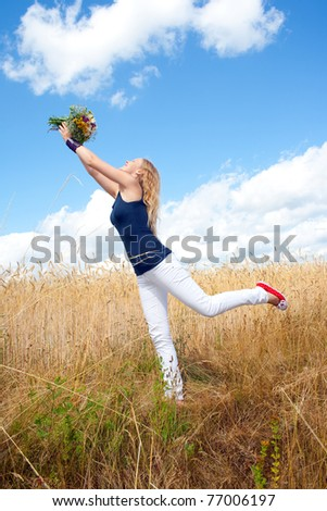 Young woman dancing with bouquet - stock photo