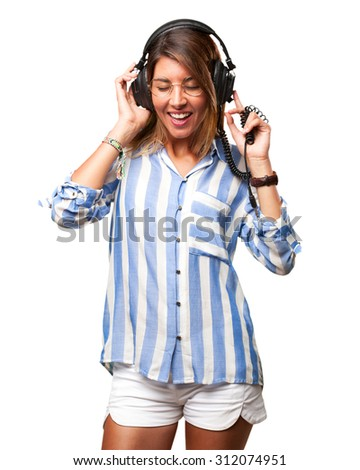 young woman dancing with headphones