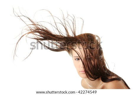 Young woman dancing with wind - stock photo