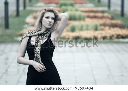 Young woman daydreaming in a rainy day - stock photo