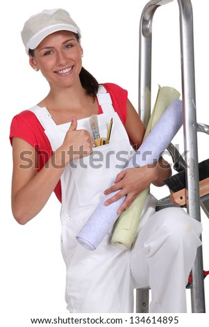 Young woman decorating - stock photo