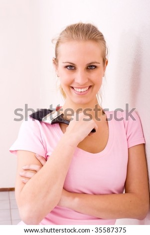 young woman decorating new home - stock photo